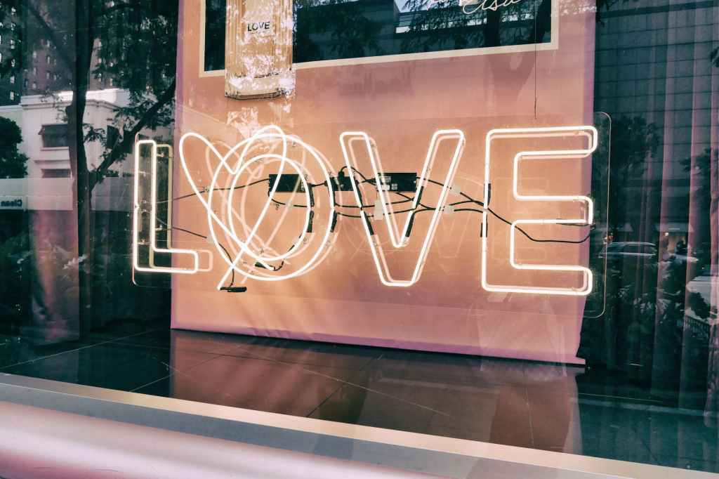Neon love sign in the window.